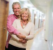 Portrait Of Happy Mature Couple, indoor poster