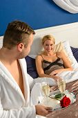 Husband flirting wife bedroom romantic evening celebration sexy nightgown poster
