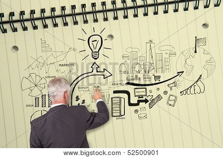 poster of Rear view of grey haired businessman touching illustrations on huge notepad