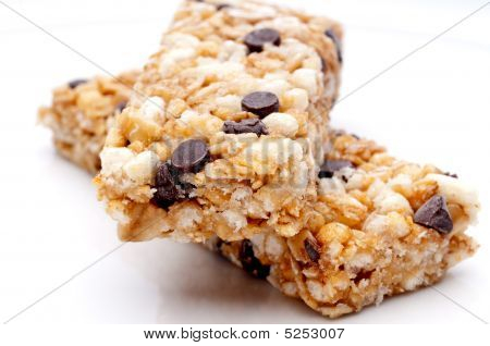 Two Granola Bars On A White Plate