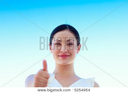 Portrait Of A Businesswoman Outdoors With Thumbs Up