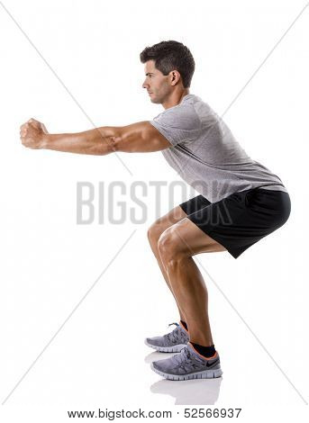 Athletic man running doing squats, isolated over a white background poster