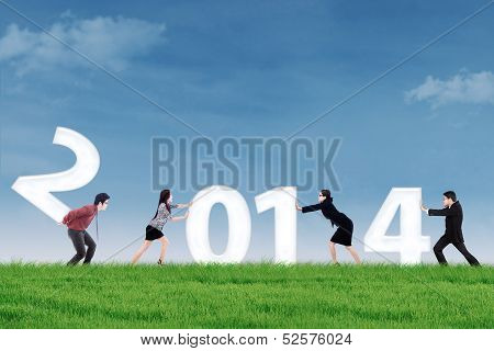 Businesspeople Arrange New Year 2014 Outdoor