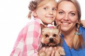 Happy family mother daughter and Yorkshire Terrier isolated on white poster