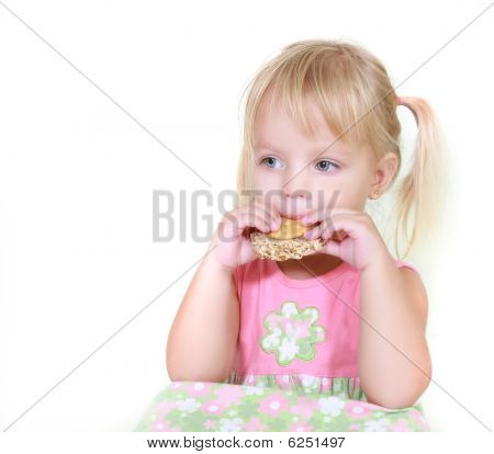 Young Girl Eating Snacks Over White