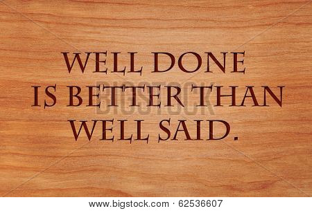 Well done is better than well said - motivational quote by Benjamin Franklin on wooden red oak background poster