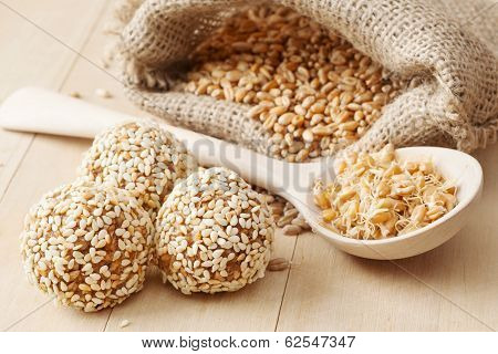 Macrobiotic Healthy Food: Balls From Ground Wheat Sprouts With Sesame Seeds, Sprouted Grains And Sac