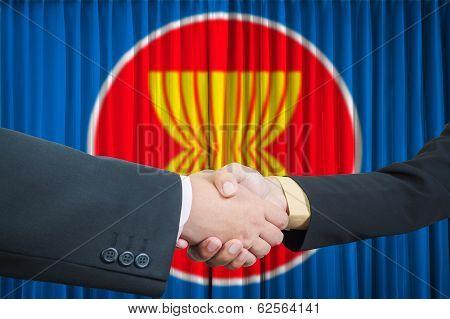 Asean Economic Community In Businessman Handshake