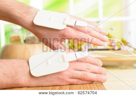Electrotherapy, electrical stimulation using surface electrode pads with a conductor gel placed on the skin.