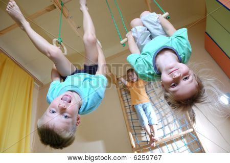 Children Hanging On Gymnastic Rings