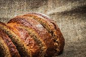 Close-up still-life with loaf of bread on burlap poster