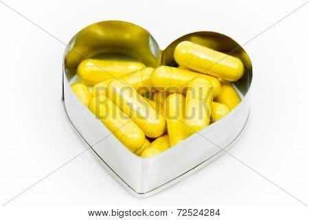 Yellow Capsules In Heart