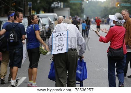 WWii veteran with signs