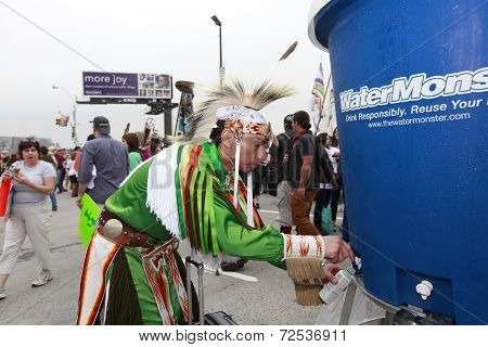 Native American at water station