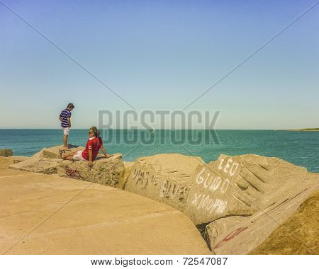 Father And Son Watching The Sea