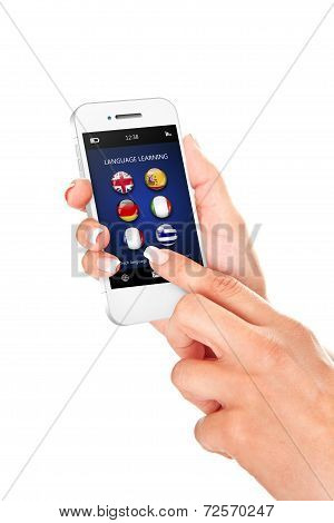 Hand Holding Mobile Phone With Language Learning Application Over White