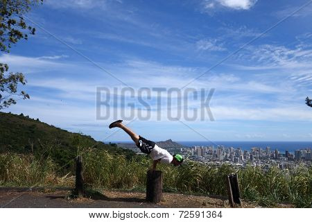 Man Does Mayurasana Or Peacock Pose On Tree Stump In The Mountains Of Oahu