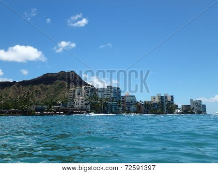 Waikiki Waves Lap Towards Seawall, With Coconut Trees, Condo Buildings, And Diamond Head Crater