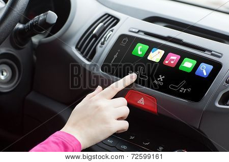 Woman Sitting In A Car And Touch Play Finger In A Auto Smart System