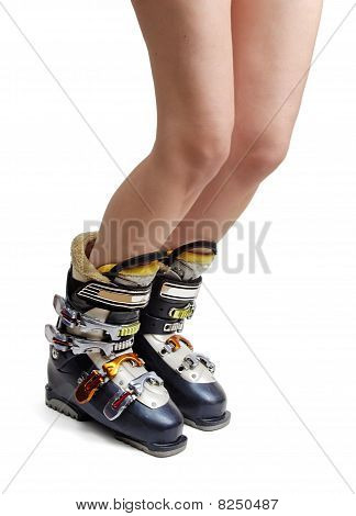 Naked female legs in ski boots