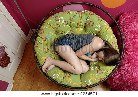 Teenager Relaxing In Her Room