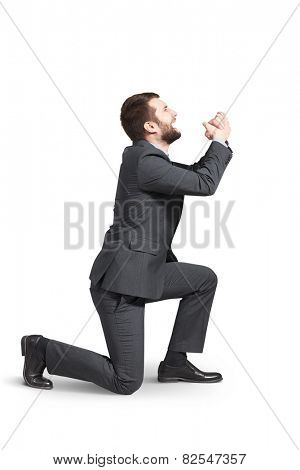 crying man standing on one knee and apologizing. isolated on white background