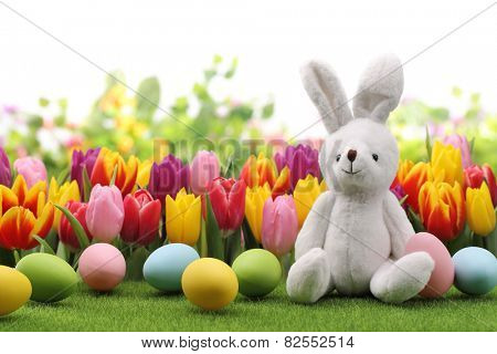 Easter decoration with rabbit,eggs and flowers.