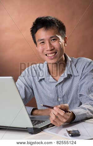 Successful business man of Chinese sitting, closeup portrait in studio.