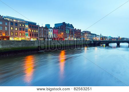 DUBLIN, IRELAND - FEBRUARY 20, 2012: Architecture of city centre at Liffey river in Dublin, Ireland. Dublin is the capital and largest city located on the east coast of Ireland.