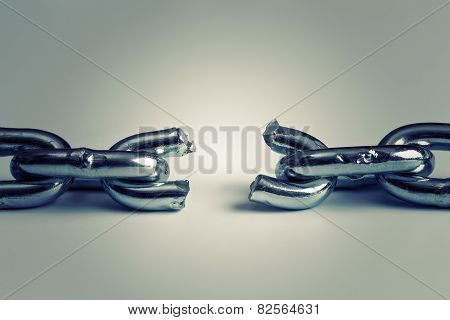 Conflict In Business Concept With Broken Chain