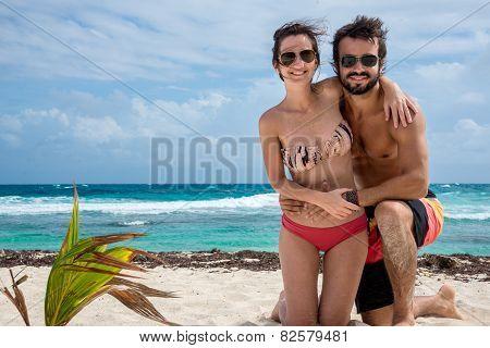 Couple Enjoying Caribbean Beach Isla Mujeres, Mexico.