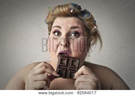 Greedy woman eating chocolate
