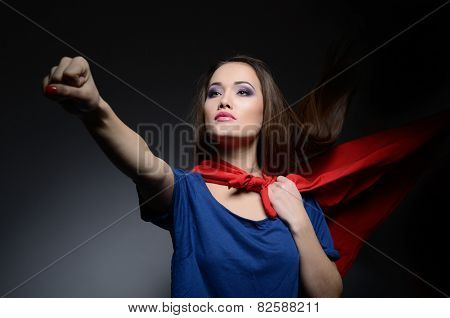 Superwoman. Young pretty woman opening her shirt like a superhero. Super girl, image toned. Beauty saves the world.
