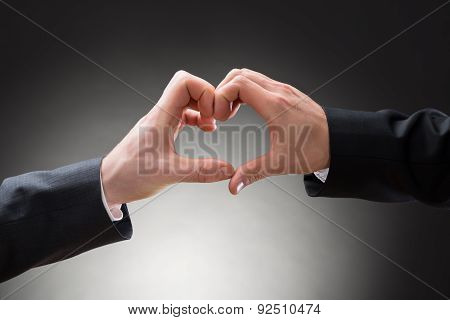 Close-up Of Gay Men Hand's Making Heartshape