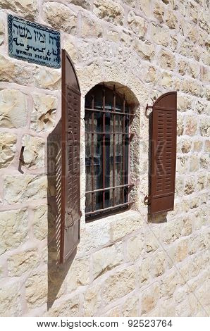 Window of an old house in Mishkenot Sha'ananim in Yemin Moshe street in neighbourhood in Jerusalem Israel.