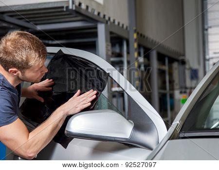 Applying Tinting Foil Onto A Car Window