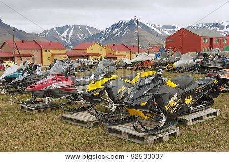 View to the snowmobiles parked outside for a short arctic summer in Longyearbyen, Norway.