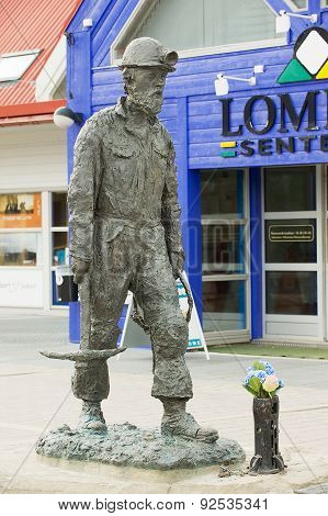 Exterior of the coal mine worker statue at the street of Longyearbyen, Norway.