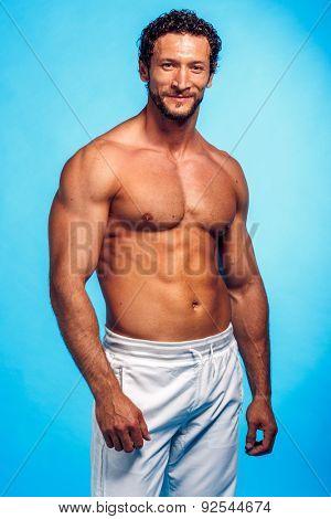 Fitness Instructor Studio Shot over Blue Background