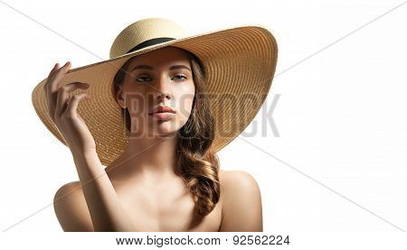 Young woman in summer straw hat