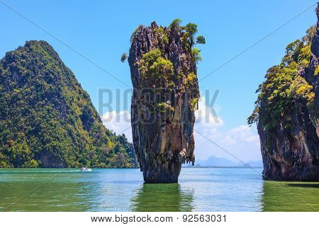 Calm and warm Andaman Sea and the quaint island. James Bond Island. Wonderful holiday in Thailand