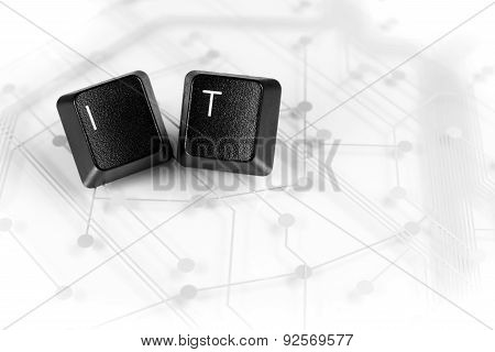 It, Two Keyboard Keys With Letters I And T On Circuit Board