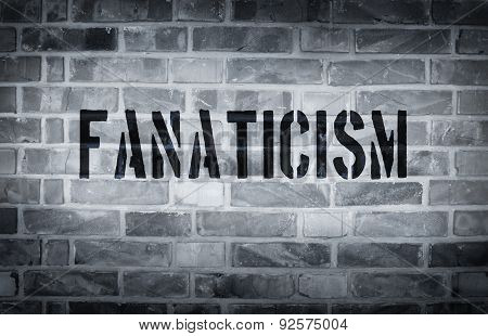 Fanaticism Stencil Print On The Grunge White Brick Wall