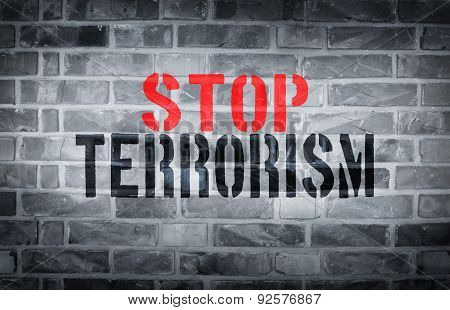 Stop Terrorism Stencil Print On The Grunge White Brick Wall