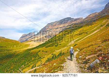 Hiker Heading Into An Alpine Valley In The Fall