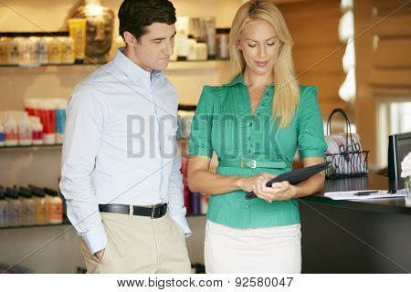 Portrait Beauty Product Shop Managers Using Digital Tablet