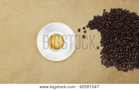 Cup Of Coffee With Beans On Marble Table