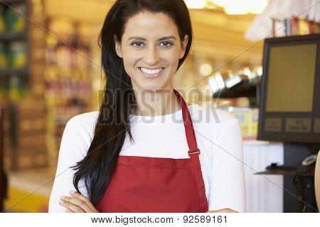 Female Cashier At Supermarket Checkout