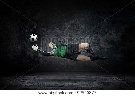 Splash of drops around football player under water