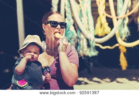 Mother on the beach eating ice-cream